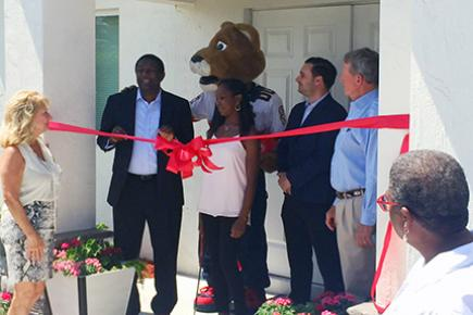 HOMES, Inc. recently celebrate a new home with a ribbon cutting.